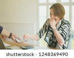 online payment man and woman ... | Shutterstock . vector #1248369490