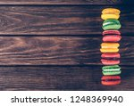 row of colorful sweet macaroons ... | Shutterstock . vector #1248369940