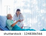 the doctor is diagnosing the... | Shutterstock . vector #1248386566