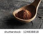 wooden spoon full of cocoa... | Shutterstock . vector #124838818