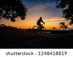 shadow of the cyclists at... | Shutterstock . vector #1248418819