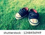 children's shoes on grass.... | Shutterstock . vector #1248456949