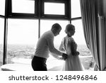 bride and groom wear clothes | Shutterstock . vector #1248496846