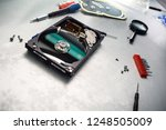 computer hard drive disassembly. | Shutterstock . vector #1248505009