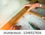 hands working repair of... | Shutterstock . vector #1248527836