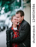 a man and a woman walk around... | Shutterstock . vector #1248534586