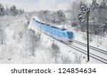 Blue And White Commuter Train...