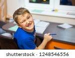 the boy winks with one eye. he... | Shutterstock . vector #1248546556
