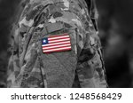 flag of liberia on soldiers arm....   Shutterstock . vector #1248568429