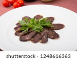 smoked horse meat sliced and...   Shutterstock . vector #1248616363