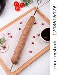 kebab meat grilled on a skewer...   Shutterstock . vector #1248616429