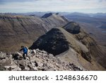 A Man Hiking On The Liathach...