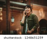 asian woman using smartphone...   Shutterstock . vector #1248651259