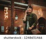 asian woman using smartphone...   Shutterstock . vector #1248651466