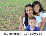 proud ethnic mother with her... | Shutterstock . vector #1248699283