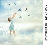 Little girl in a blue dress with blue butterflies (Fantasy) - stock photo