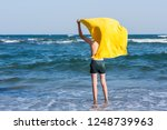back view on the boy standing... | Shutterstock . vector #1248739963