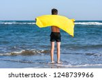 back view on the boy standing... | Shutterstock . vector #1248739966