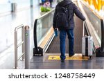 a business man is walking to... | Shutterstock . vector #1248758449
