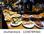 tasty tapas to pick at the... | Shutterstock . vector #1248789460