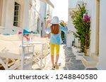 pretty little girl holding her... | Shutterstock . vector #1248840580