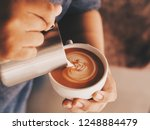 close up barista hands pouring... | Shutterstock . vector #1248884479