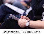 young people taking notes on... | Shutterstock . vector #1248934246