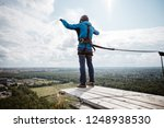 rope jumping is an extreme...   Shutterstock . vector #1248938530