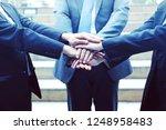 close up teamwork handshake... | Shutterstock . vector #1248958483