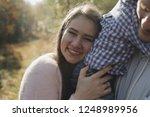 mom leaned on the back of her... | Shutterstock . vector #1248989956