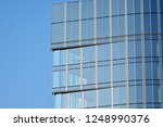 view of modern glass skyscraper ... | Shutterstock . vector #1248990376