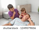 children painting their father...   Shutterstock . vector #1249079836