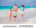 happy beautiful family on white ... | Shutterstock . vector #1249080820