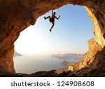 rock climber at sunset.... | Shutterstock . vector #124908608