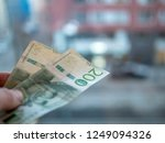 person is paying with swedish... | Shutterstock . vector #1249094326