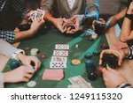 young friends playing poker on... | Shutterstock . vector #1249115320
