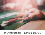 young friends playing poker on... | Shutterstock . vector #1249115770