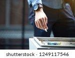 man hand putting out cigarette...   Shutterstock . vector #1249117546