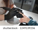 the process of removing nail... | Shutterstock . vector #1249139236