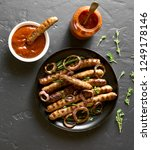 fried sausages on plate and... | Shutterstock . vector #1249178146