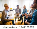 group of people sitting in a... | Shutterstock . vector #1249185376