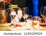 the bartender pours champagne.... | Shutterstock . vector #1249229929