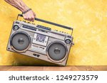 retro outdated portable stereo... | Shutterstock . vector #1249273579