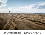 a lone man is standing on an... | Shutterstock . vector #1249377643