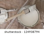 paint brush resting on paint... | Shutterstock . vector #124938794