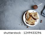 crepes with chocolate spread... | Shutterstock . vector #1249433296