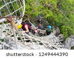 people who enjoy hiking at... | Shutterstock . vector #1249444390