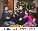 christmas morning. happy family ...   Shutterstock . vector #1249519939