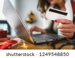young woman buying online at... | Shutterstock . vector #1249548850