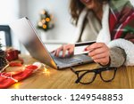young woman buying online at... | Shutterstock . vector #1249548853